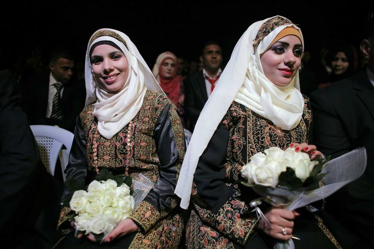 Palestinian brides sit on stage during a mass wedding ceremony in the West Bank city of Jericho January 28, 2014. A spokesman working together with the Palestinian Presidential Office said some 300 Palestinian couples, 80 of them from the Gaza Strip, wed on Tuesday in the mass ceremony funded by the Presidential Office and attended by President Mahmoud Abbas. Each couple would also be given $4,000, the spokesman said.