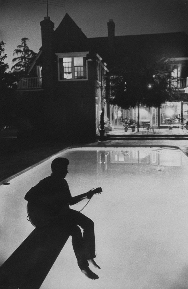 ... 17-year-old Ricky Nelson plays guitar in the back yard of his family home in Hollywood, 1958 ... photo by Hank Walker