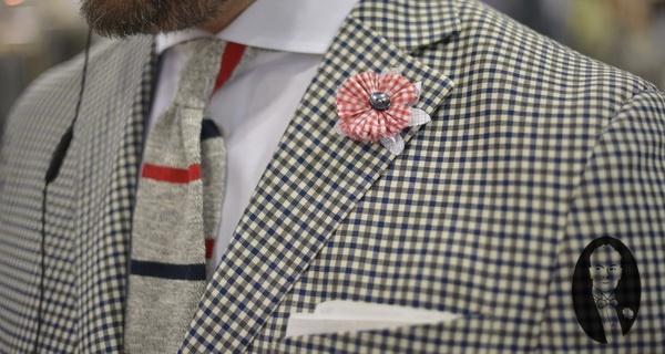 Checked Coat with Grey Knit Tie & Shirt Fabric Boutonniere via http://www.gentlemansgazette.com/mrket-las-vegas-details/