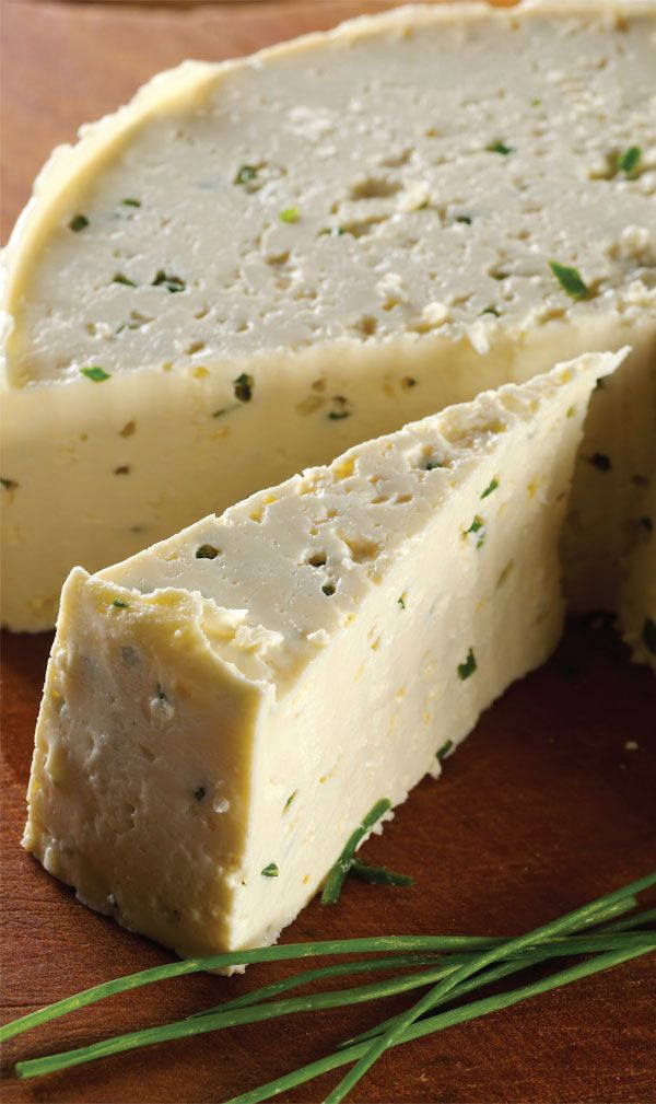 Garlic and Chive Cheese is a fresh, pressed cheese. It can be made and eaten in the same day. It slices very nicely and makes a great addition to any cheese tray. This is a family favorite that all of my kids just loved. The cheese has a sweet, milky taste. It's delicious as is or with crackers.
