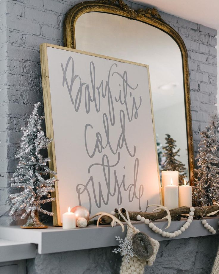 """""""Last week I shared a glimpse at our mantel and this week I am excited to reveal the whole look! This """"Baby It's Cold Outside"""" sign was a must have!! Not…"""""""