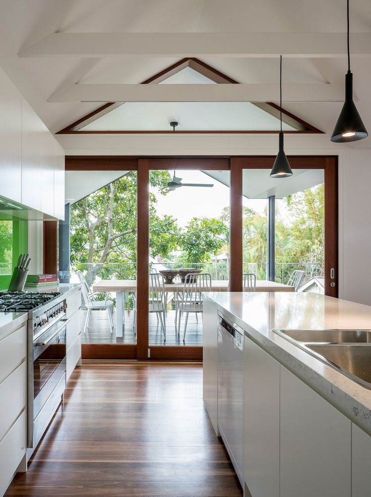 Bright, light kitchen with exposed raked ceiling