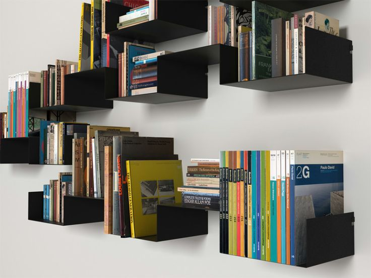 sometimes a large bookshelf can totally dominate your decor hereu0027s a nice alternative by designer carme pinos