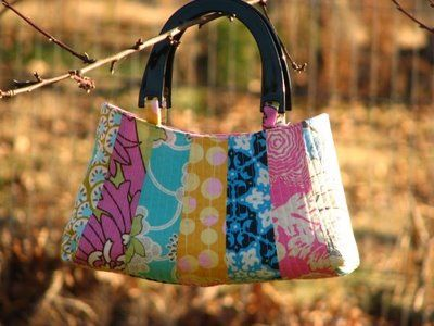 this page has many free bag patterns.  this particular bag uses scraps of material - and who doesn't already have bits and pieces of material laying about just waiting for the perfect project??