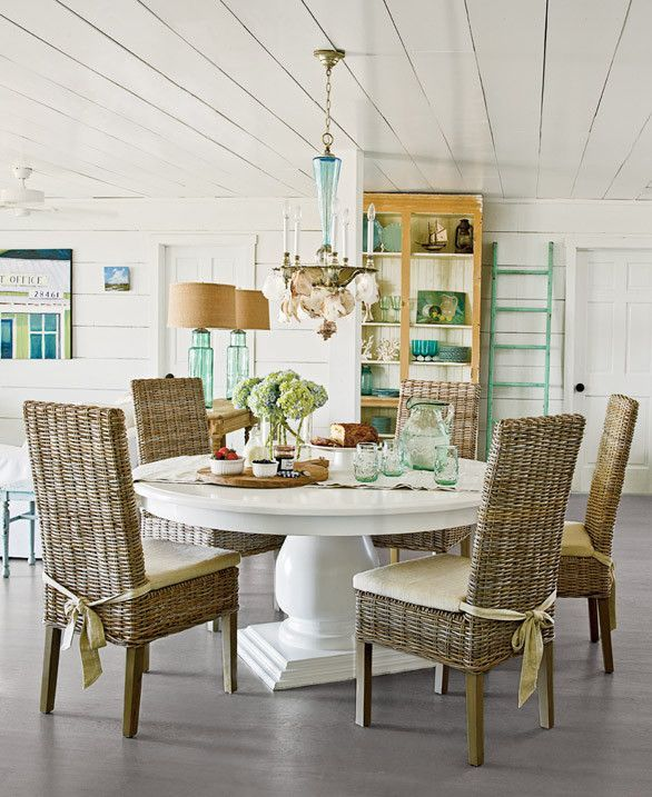 Beach Style Dining Room With Round White Table And Wicker Parsons Chairs Designbeach Ideas
