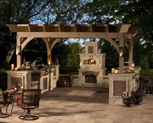 Awesome outdoor kitchen with pizza oven and all the bells and whistles. Design created using unilock pavers. #outdoorliving www.HomeChannelTV.com