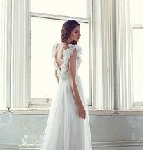 Ella wedding gown. Detail: Low back soft tulle Grecian draped gown with ruffled shoulder detail.