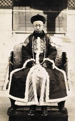 Puyi  溥儀  (7 February 1906 – 17 October 1967), of the Manchu Aisin Gioro clan, was the last Emperor of China, and the twelfth and final ruler of the Qing Dynasty. He ruled as the Xuantong Emperor from 1908 until his abdication on 12 February 1912. From 1 to 12 July 1917 he was briefly restored to the throne as a nominal emperor by the warlord Zhang Xun.