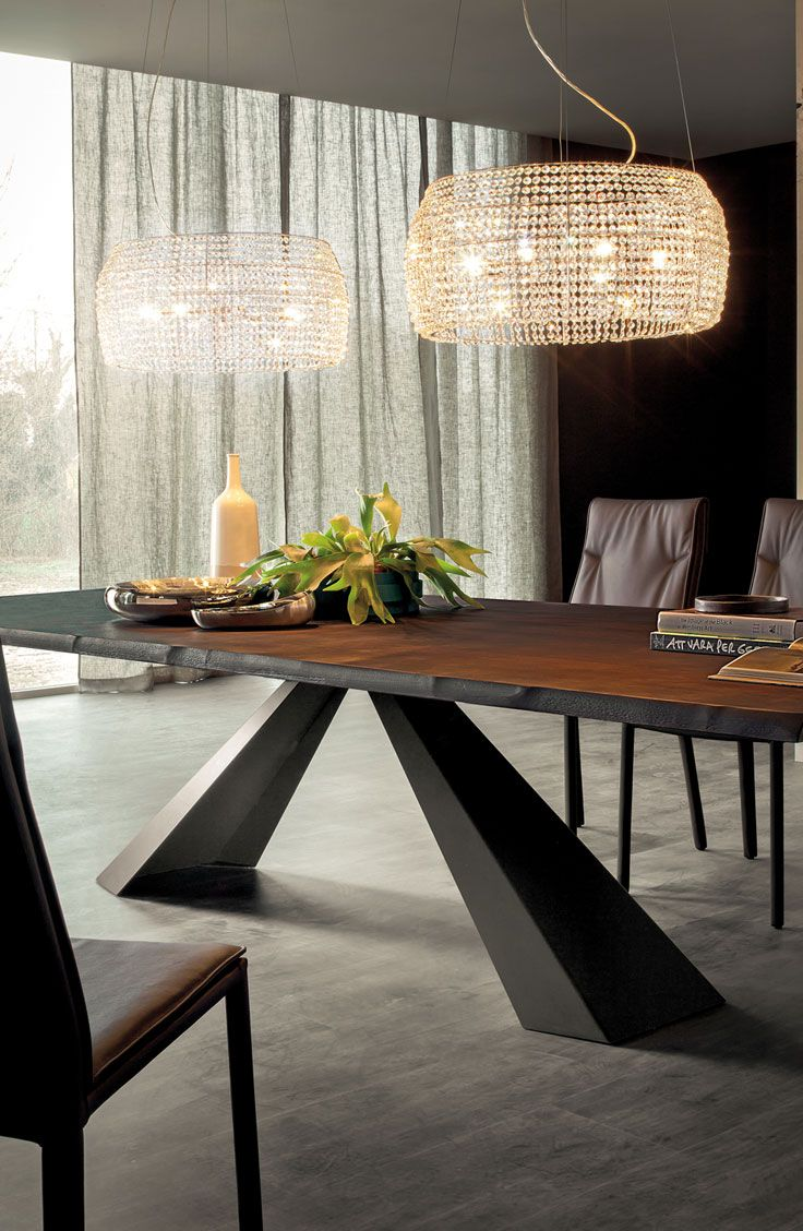 Eliot Wood is a table with irregular edges designed by Giorgio Cattelan. Its bold design features base in black, white or graphite embossed lacquered steel or in satin stainless steel and top in Canaletto walnut, burned oak or natural oak.