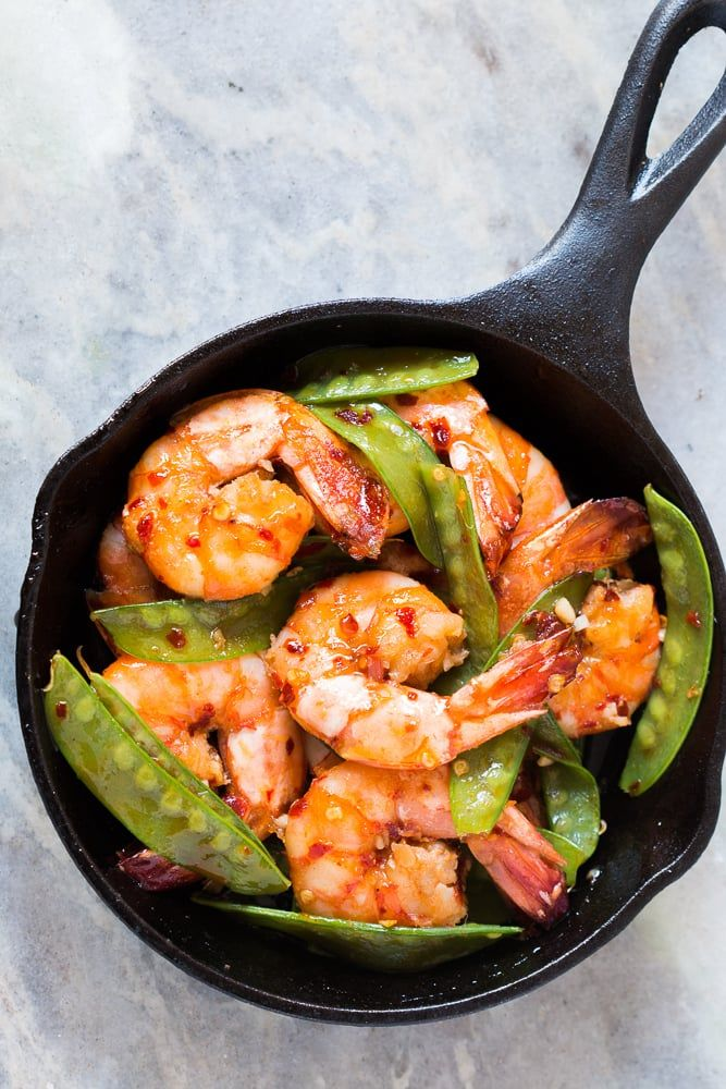 Looking for meals that take under 15 minutes? This is it - 5 ingredient honey garlic chilli jumbo tiger prawns! All the asian flavours you love in this one easy recipe! You can use shrimp, prawns or scampi and add whatever veggie you like - broccoli, bok choy, beans or even spinach! Soy free, gluten free, probably Whole30 and nut free!