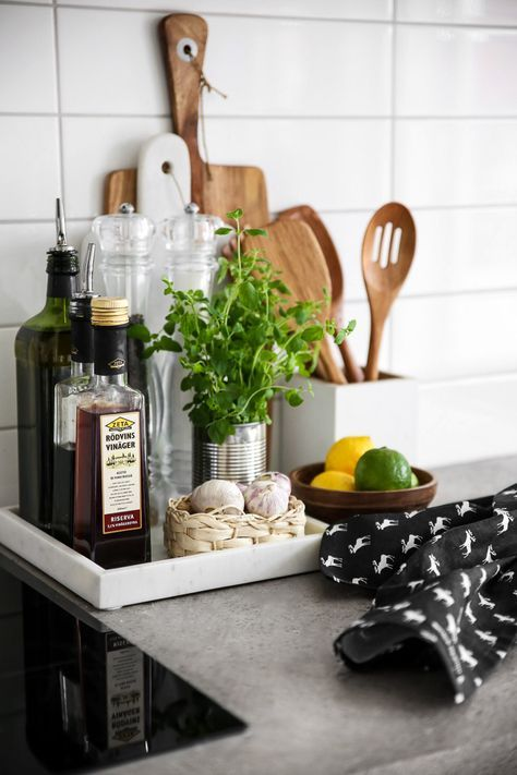 Trays are a great way to contain clutter on counters, and keep everyday cooking essentials easily accessible and organised