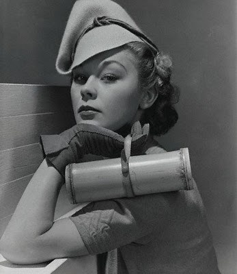 I don't know which I love more, the incredible hat or the bamboo handbag, 1938
