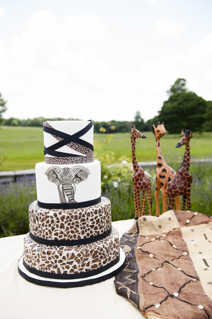 A four tier leopard print wedding cake inspired by the big game of Africa.