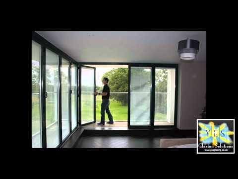 A demonstration of Sunflex bi-folding doors with moveable corner post. & 7 best Lanai u0026 Garage Doors images on Pinterest   Carriage doors ...