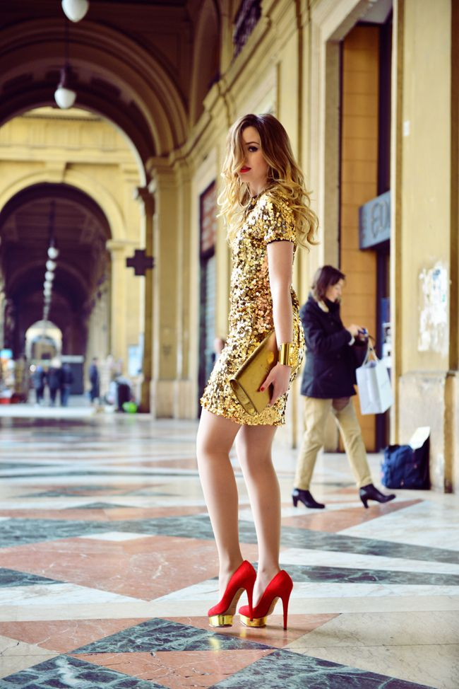 Shop this look on Lookastic: https://lookastic.com/women/looks/gold-sheath-dress-red-pumps-gold-clutch/15119 — Gold Sequin Sheath Dress — Gold Bracelet — Gold Leather Clutch — Red Suede Pumps