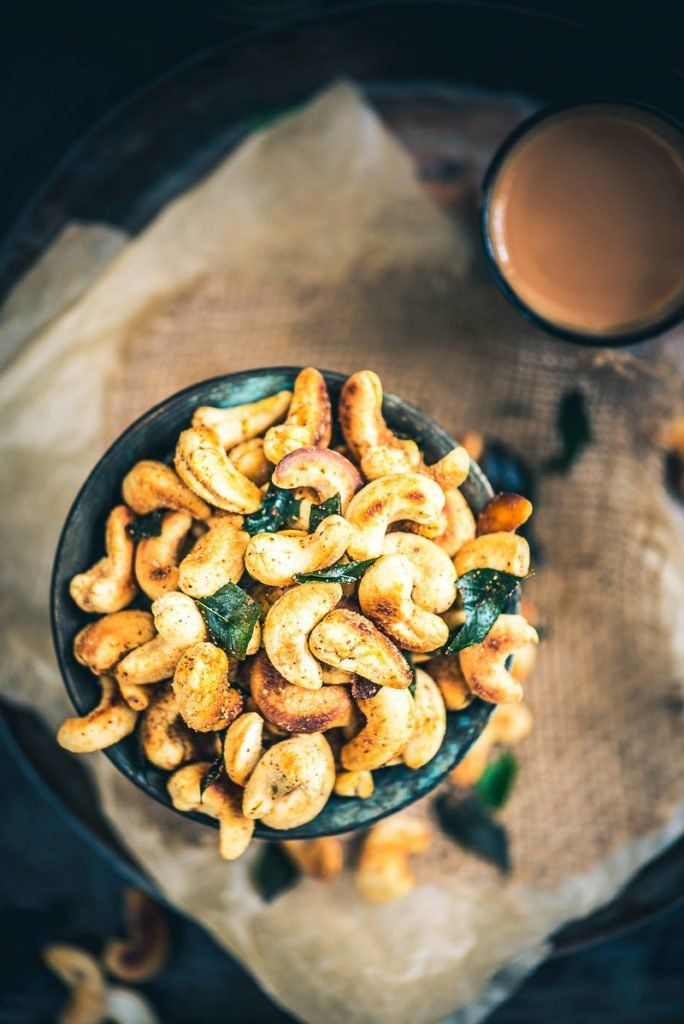 A bowl full of cashew nuts, toasted with ghee and just enough masala to satisfy that Indian soul of yours, this recipe of Spicy Masala Kaju is a keeper. #Indian #Dry #Snacks #Holi #Diwali #Festival