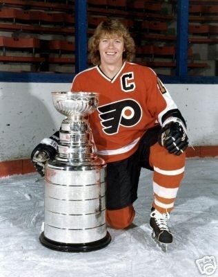 Bobby Clarke taking a moment to pise with some well earned hardware! #flyers #hockey #stanley #cup #vital