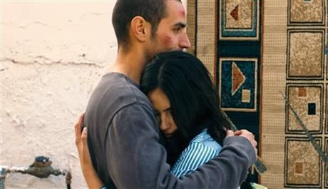 """This film image released by Adopt Films shows Adam Bakri, left, and Leem Lubany in a scene from the film """"Omar."""" (AP Photo/Adopt Films) ▼16Jan2014AP