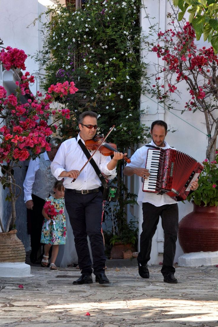 Orchestra plays greek traditional wedding songs, a great way to give a greek touch to your wedding on Skopelos. Skopelos wedding by daphneweddings