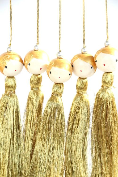 oh tassel dolls I love tassel dolls mine never had faces but I would make them dance and sway..