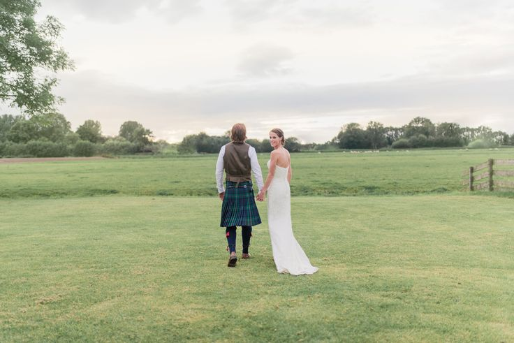 Bride and groom photo idea: walk into the evening sunset together. Notice the incredibly cool wedding kilt. #wedding photography