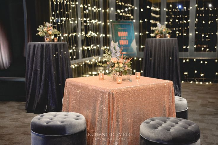 Surrounded by cascading fairylights this Copper, Navy and Teal palette created the perfect setting for this event. From custom elements including self standing drink menus, welcome signage and high bar art work. Stunning florals arranged in copper geo vase complimenting the overall event colour palette. A mix of matte navy and rose gold sequin linen adorned the tables, with candlelight adding that extra illuminate touch.Youtube: https://www.youtube.com/watch?v=hmLfUhZHAMs&feature=youtu.be