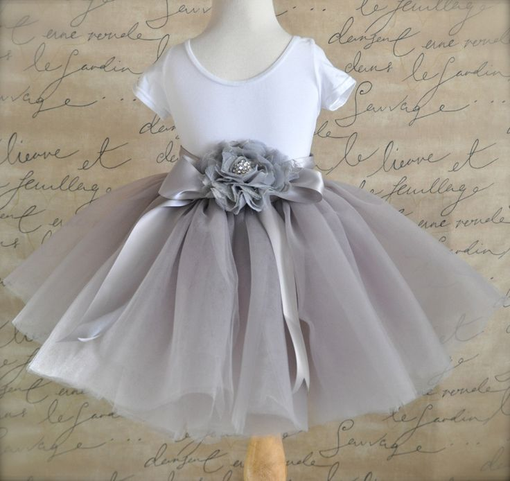 Dove grey Flower Girl short 8 layer tutu with silver satin ribbon sash waist. Sewn, no tied knots.. $78.00, via Etsy.