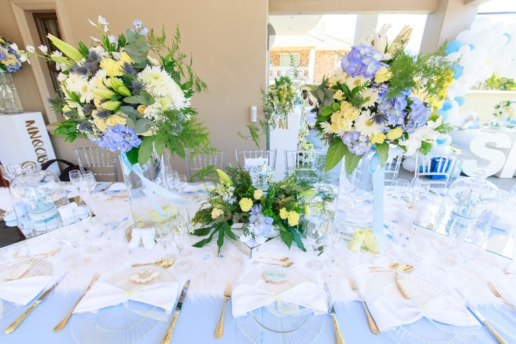 Dreamy baby shower table decor with touches of white, blue and gold