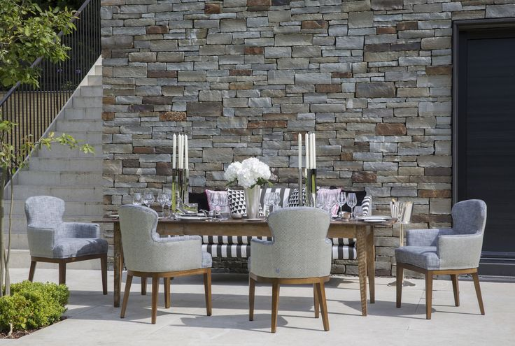 Coco Wolf outdoor Sammarco dining chairs and Mamelle sofa.