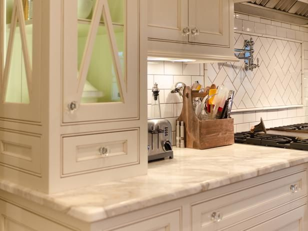 To give the kitchen a classic high-end look, the upper cabinets that frame the cooking wall extend from the ceiling all the way down to the marble countertop.Kitchen Layout Design Ideas : Home Improvement : DIY Network