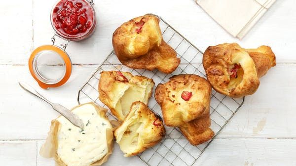 Recipe with video instructions: Enjoy these crisp, airy golden popovers even more with a sweet, delicious strawberry compote. Ingredients: 3 large eggs, 1 ¼ cups whole milk, 1 ¼ cups flour, ¼ tsp fine sea salt, 1 Tbsp unsalted butter, melted, 1 ½ Tbsp unsalted butter, cut evenly into 6 pieces