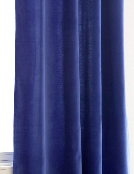 Interior design Kate Albrecht believes these rich blue velvet curtains as a way to bring in a luxurious textile and color to a bedroom. Find out what other celebrity interior designers buy from Zara Home!