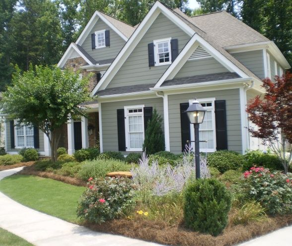 love the gray siding with white trim and dark navy shutters