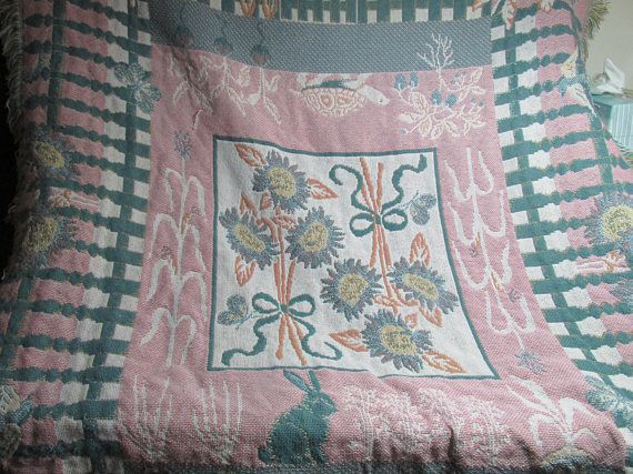 The blanket has a garden theme woven into this cotton tapestry throw blanket. The walk in the garden shows off sunflowers, turtles, butterflies, rabbits, corn, radishes, and a fence surrounds it all. The blanket measures about 57 x 43 plus fringe. The blanket is preowned, and has a couple snagged threads. It is not torn, and no holes. The blanket was purchased at an auction. It is clean and ready for use. We are pet-free and smoke free home.