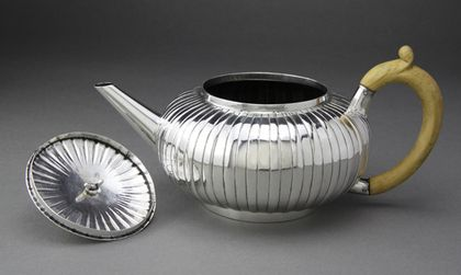 """The makers mark RZ under acorn is very clear , which was used by Zouch between 1734 and 1739. The lid is unmarked. Richard Zouch was freed in 1737, he worked from Chequer Court in Charing Cross. Analysing the melon shape and form of this teapot, it is transitional, following the spherical bullet teapots that were in fashion between 1725 and 1740. We quote Douglas Ash (Dictionary of British Antique Silver, pg 172), """"In the second quarter of the 18th century"""