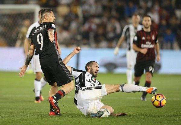 Giorgio Chiellini of Juventus FC in action against Gianluca Lapadula of AC Milan during the Supercoppa TIM Doha 2016 match between Juventus FC and AC Milan at the Jassim Bin Hamad Stadium on December 23, 2016 in Doha, Qatar.