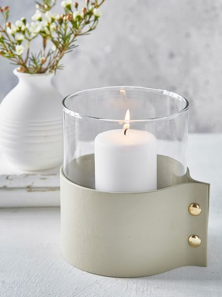 loving the mix of materials here. contemporary, unique, sleek, simple, beautiful - measures D12.5xH15cm | Sleeve width 14cm £16.00 from nordic House. Pillar candle = 6 x 7cm (£2.50) and white sand gravel (recommended) is £4.95. Not big enough as a feature in its own right but a lovely piece for the jigsaw puzzle