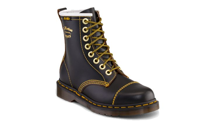 Doc Marten boot in black with yellow stitching.