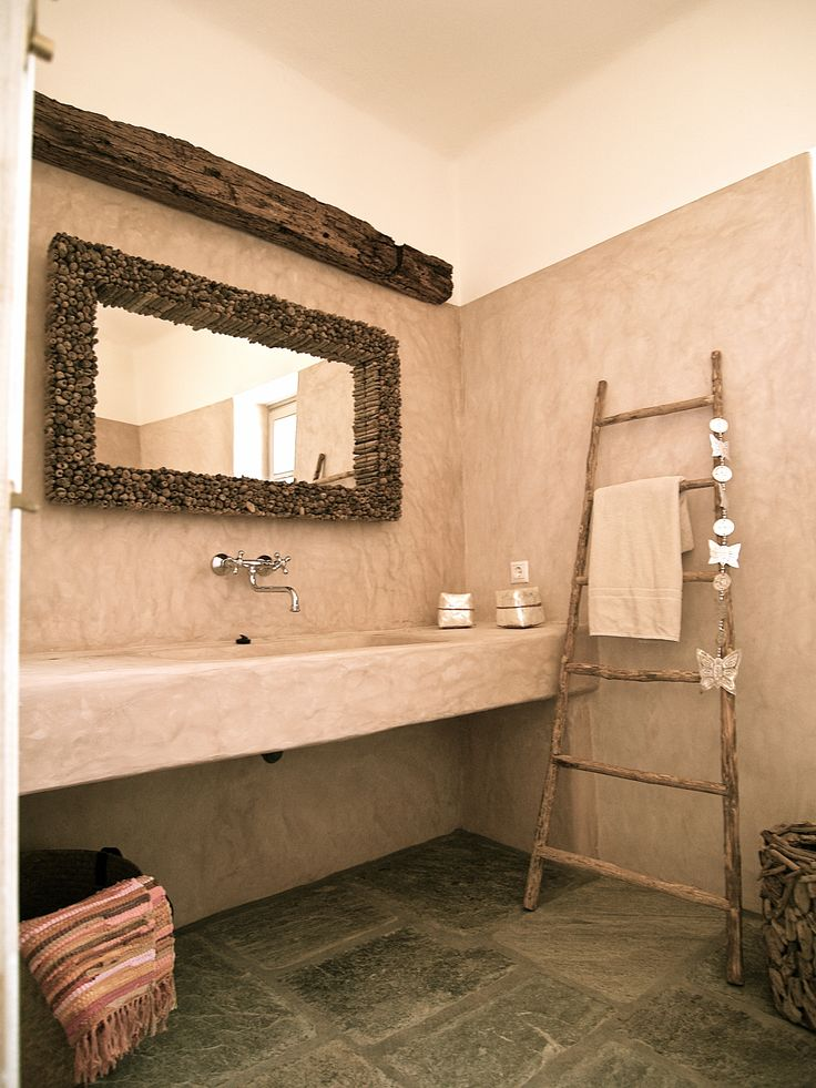 St. Arsenios, Paros island, Greece. Cement mortar in a traditional built bathroom with a concrete wash basin.
