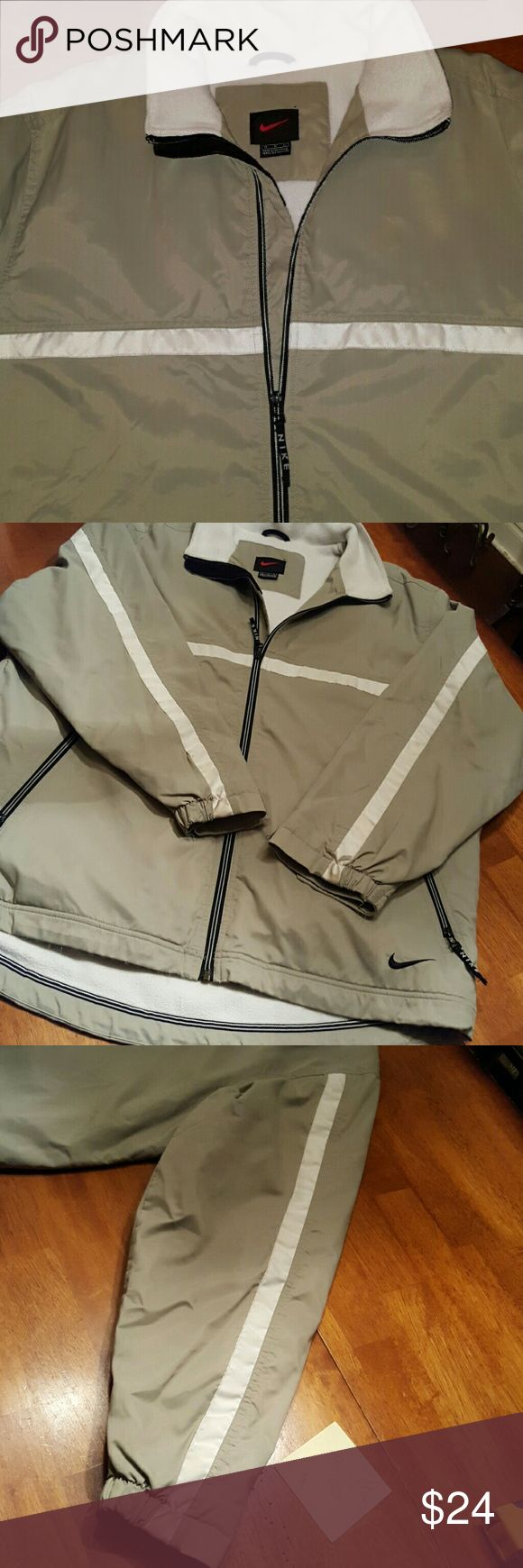 MEN'S NIKE LAB LINED JACKET Nike men's windbreaker style jacket.  It has a nylon wind resistant outer shell and a white pile lined inside with nylon lined sleeves. Zippered outer pockets.  Black Nike Swoosh.  Inside velcro closure pocket.  Great condition. Gently worn,  from a clean non smoking home.  No odors,  rips,  stains or tears. Quality jacket,  great for golf or any outdoor activity.  Guaranteed to keep you warm on a blustery day. Nike  Jackets & Coats