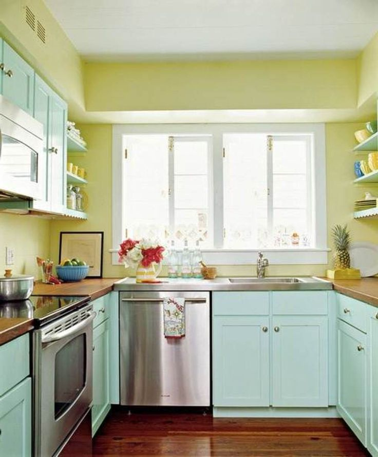 Modern Style Green Lime Kitchen Island with Wooden Floor and U Shape White Wood Kitchen Interior with Chrome Oven plus Stove Designs and Wall Mounted Shelves also White Window Sets and Wood Countertop