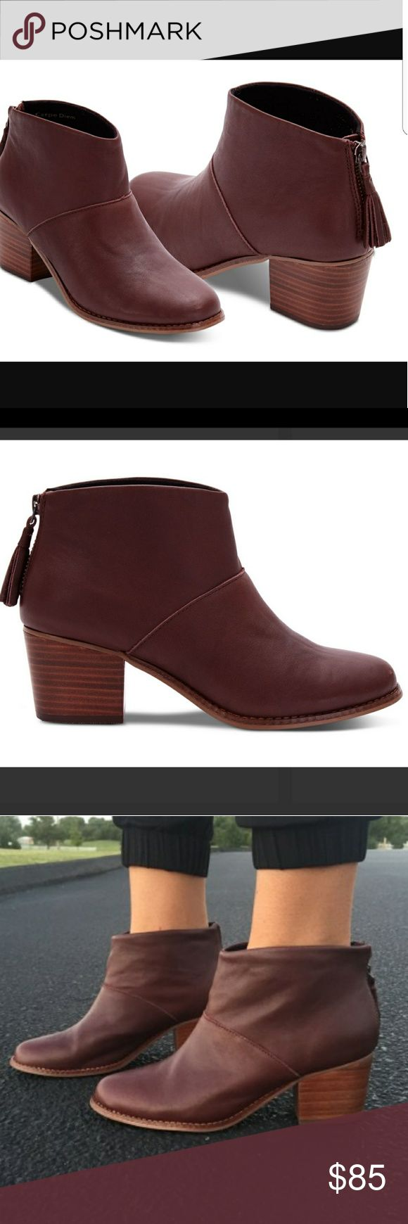 TOMS Oxblood Leather Ankle Boot Don't even think about transitioning seasons without a new ankle bootie in your collection. TOMS ankle boot starts with a stacked mid-heel and zips up the back for easy entry and a streamlined look, with a leather tassel for a playful touch. You'll wear this versatile staple with everything from skirts to cuffed jeans. TOMS Shoes