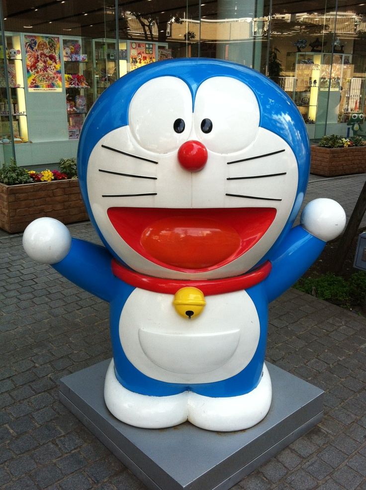 """Doraemon, popular manga and anime character. The name can be translated roughly to """"stray."""" Unusually, the name is written in a mixture of Katakana (ドラ) and Hiragana (えもん). """"Dora"""" derives from """"dora neko"""" (brazen or stray cat, どら猫), and is a corruption of nora (stray). """"Emon"""" 衛門、右衛門 is a component of male given names like Goemon. """"Dora"""" is not derived from dora 銅鑼, meaning gong, but due to the homophony the series puns on this, with Doraemon loving dorayaki, red bean pancakes shaped like a…"""