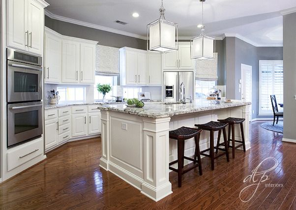 painted the walls a rich grey, created a custom one level island, modified the existing cabinets, added granite, updated the lighting, added cabinet hardware, and completed the look with a few simple accessories.   The space is now sleek, sophisticated, and more functional. The