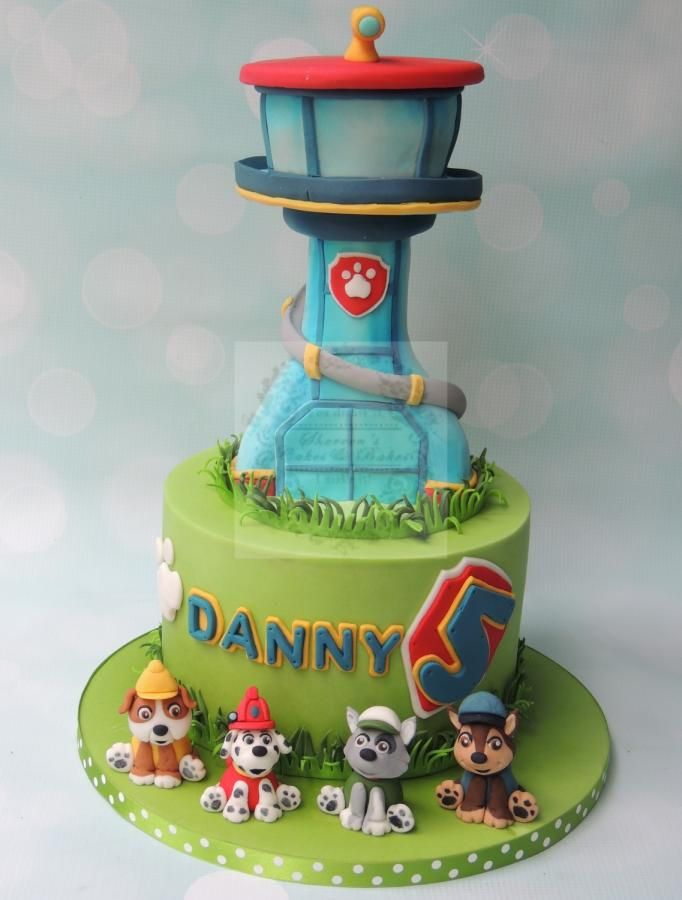Can't get enough of these intricate lookout tower Paw Patrol cakes. This one is complete with edible pups!