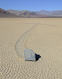 Sailing stones, sliding rocks, and moving rocks all refer to a geological phenomenon where rocks move in long tracks along a smooth valley floor without human or animal intervention. They have been recorded and studied in a number of places around Racetrack Playa, Death Valley, where the number and length of travel grooves are notable. The force behind their movement is not confirmed[1] and is the subject of research for which several hypotheses[2] exist. Th