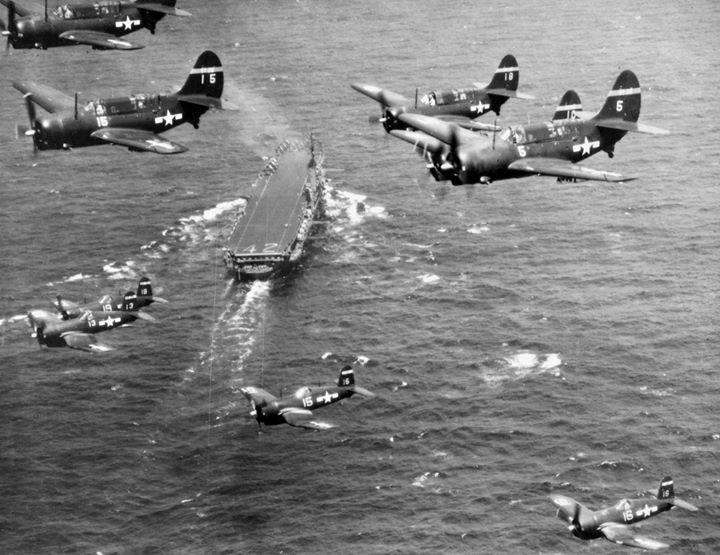 F4U-4 Corsair aircraft of US Navy squadron VF-75 and SB2C-4E Helldiver aircraft of US Navy squadron VT-75 in flight over USS Franklin D. Roosevelt western Atlantic Ocean 5 May 1946.