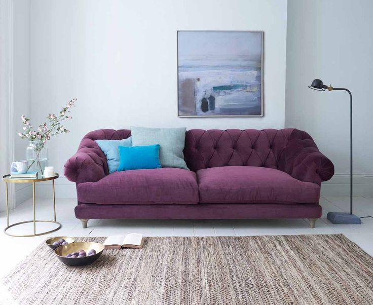 Loaf's comfy Bagsie sofa is handmade in Derbyshire. A contemporary take on the traditional Chesterfield design, this deep button backed has solid oak legs and the frame is guaranteed for 10 years. Available in more than 120 fabrics and shown here in the purple Grape clever velvet.