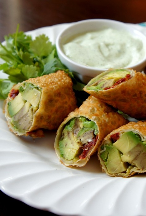 Avocado Egg Rolls with Creamy Cilantro Ranch Dip. These were sooo good. I did add a little red onion and a tiny lime. Also a little chicken. Will make again.
