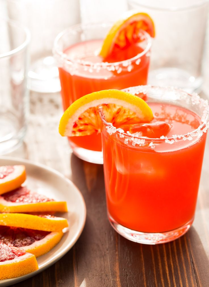 Need a batch cocktail recipe for a party? Whip up a pitcher of these gorgeous Blood Orange Margaritas ahead of time and relax with your guests instead of tending bar! ~ http://www.garnishwithlemon.com